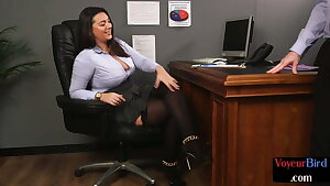 Busty office voyeur taunting subject's dick with her soles