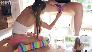 Talia Mint Challanges her Girlfriend while Fucking her Pussy under Table